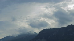 Big clouds scudding over the mountains Stock Footage