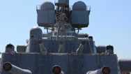 Silhouette of warship superstructure with cannon guns of view from the bow deck  Stock Footage