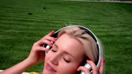 Pregnant woman with headphones listening to music Stock Footage