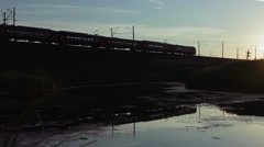Trans-Siberian Railway train Passes Over The Railway Bridge On Sunrise Stock Footage
