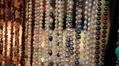 Amber and pearl beads Stock Footage
