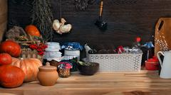 Domestic stocks with marinated vegetables in glass jars on a wooden shelf. Pa Stock Photos