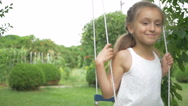 The girl riding on a swing in the park Stock Footage