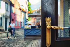 Brass door handle on the background of the street Stock Photos