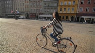 Beautiful young woman smiling while riding her bicycle on a sunny summer day Stock Footage