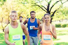 Happ young sportsmen racing wit badge numbers Stock Photos