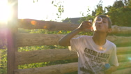 Boy Blowing Soap Bubbles At Sunset Stock Footage