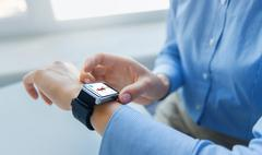 Close up of hands with fitness app on smart watch Stock Photos