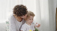 Mother Teaching Toddler To Blow Bubbles Stock Footage