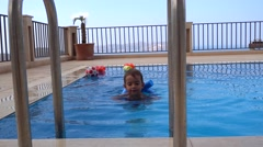 Kid learns to swim with noodle 2 Stock Footage