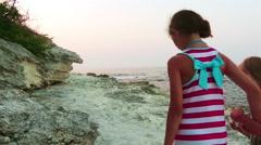 Two little girls walk near Tsarevo in Bulgaria Stock Footage