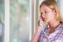 Anxious Young Woman Phoning Helpline Stock Photos
