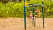 Little sisters playing on playground Stock Footage