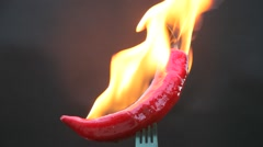 Hot chilly on fork with fire Stock Footage