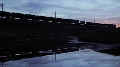 Train Passes Over The Railway Bridge, Silhouette Of Train Crossing Bridge Stock Footage