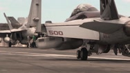 F-18 Hornet taxing on the deck of Aircraft carrier Stock Footage