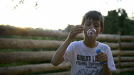 Boy Fails to Blowing a Bubble, Bursts the Bubble Stock Footage