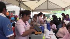 Nurses volunteering time working assisting locals Stock Footage