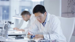 4K Electronics engineers working in lab building & testing electronic devices Stock Footage