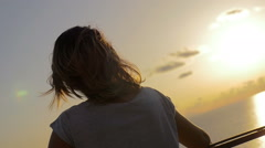 Thoughtful girl back while meditating watching the sea Stock Footage