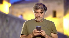 Middle-aged  tourist  sends text messages to his mistress Stock Footage