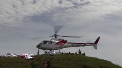 Helicopter takes off from hilltop Stock Footage