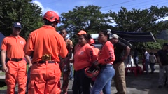 Panamanian security in red uniforms directing civilians Stock Footage