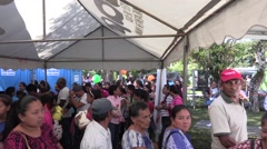 Elderly group standing in line under shaded tent Stock Footage