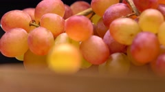 Red and orange grape bunch 4K macro pan shot, shallow DOF Stock Footage