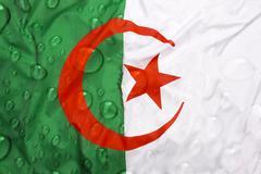 Flag of Algeria with rain drops Stock Photos