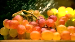Sprinkling water over multicolor grape bunch. Super slow motion video Stock Footage