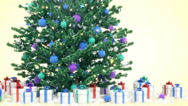 Christmas tree with gifts, falling snow Stock Footage