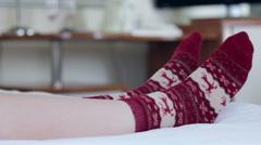 Female legs in Christmas socks Stock Footage