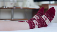 Female legs in Christmas socks Stock Footage