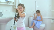 Little girls doing the beauty in the bathroom Stock Footage
