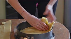 Baker forms pie crust ridges by hand Stock Footage