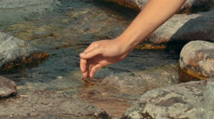 Both male hands in water Stock Footage