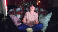 4k Authentic Shot of a Funny Woman Watching Comedy Movie with Popcorn Stock Footage