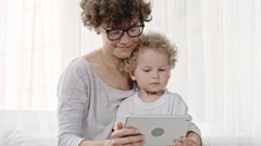 Mother and Toddler with Tablet Stock Footage