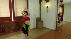 Oriental dance. The red-haired young pretty girl performing a belly dance. 4K Stock Footage