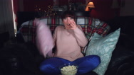 4k Authentic Shot of a Funny Woman Watching Horror Movie with Popcorn Stock Footage