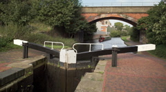 Boat heading toward Birmingham on the Grand Union Canal. Stock Footage