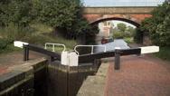 Boat heading toward Birmingham on the Grand Union Canal. Stock Footage