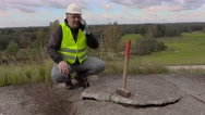Worker talking on phone at broken concrete slabs Stock Footage