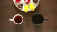 Black tea in mugs. lunch. table with a drink and dessert. view from above Stock Footage