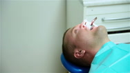 Patient With Dental Spatula In Mouth Stock Footage