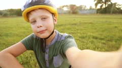 Kid making photo of himself and his bike at scenic countryside nature background Stock Footage
