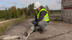 Worker with sledgehammer beats concrete Stock Footage