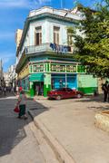 HAVANA, CUBA - APRIL 1, 2012: Tourists walk on the Aguacate street Stock Photos