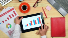 Woman Using Touch Pad With Chart Stock Footage